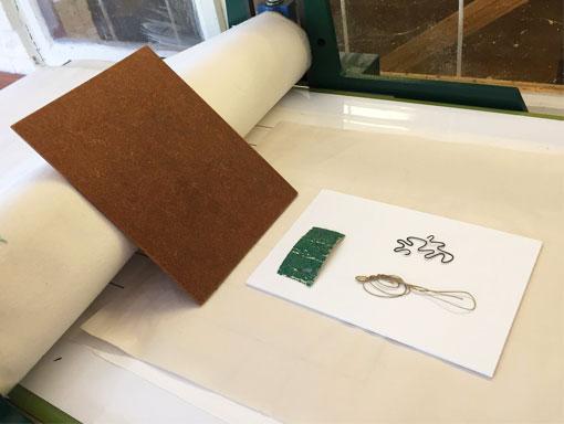 foam board plate on the press, ready to emboss