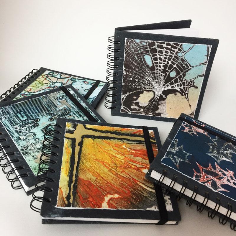 display of several sketchbooks