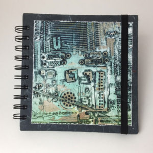sketchbook with computer print on cover