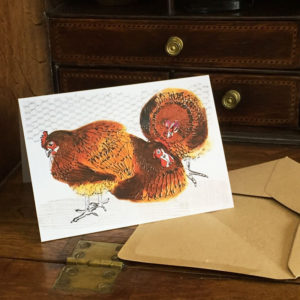 'chickens' card displayed on writing desk