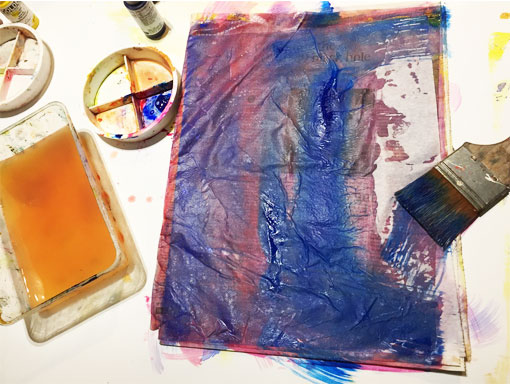 Painting wet strength tissue with acrylic paint
