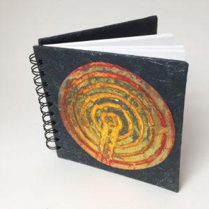 sketchbook with original petroglyph print cover