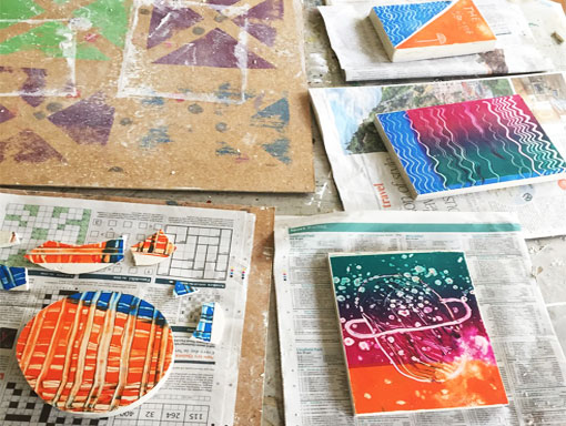 a collection of plaster mono prints