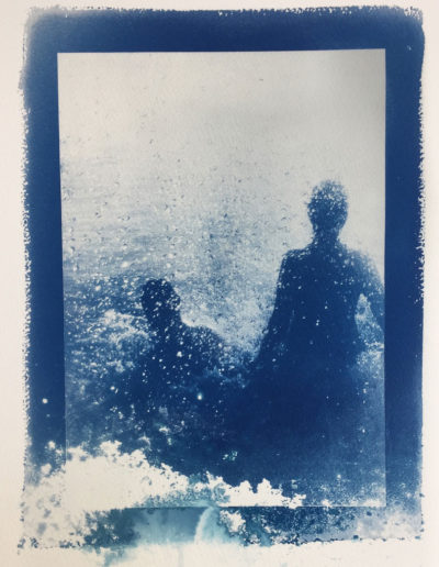 cyanotype of two people in tumbling water hot spring