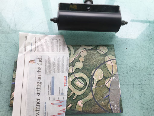 newspaper masking a collagraph plate