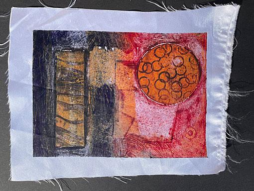 collagraph print on shiny satin fabric