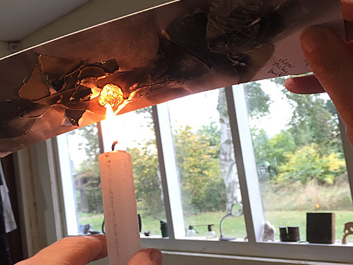 burning a printing plate with a candle