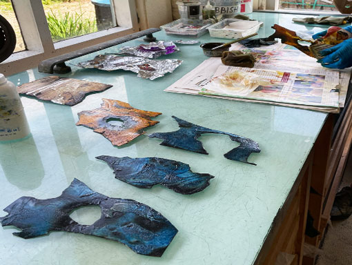 inked collagraph plates on the bench