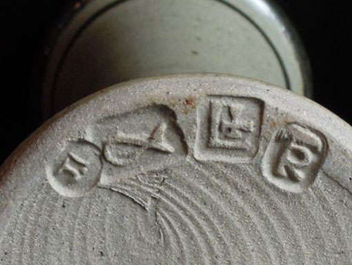 clay pot with potters stamp on it